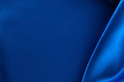 Abstract silk luxury background, piece of cloth, deep blue cloth texture