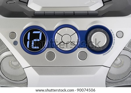Abstract silver control panel from mass production electronic device background.  Selective focus
