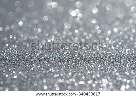 Abstract silver glitter holiday background. Winter xmas holidays. Christmas.
