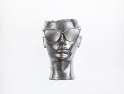 abstract silver mannequin head isolated on white background