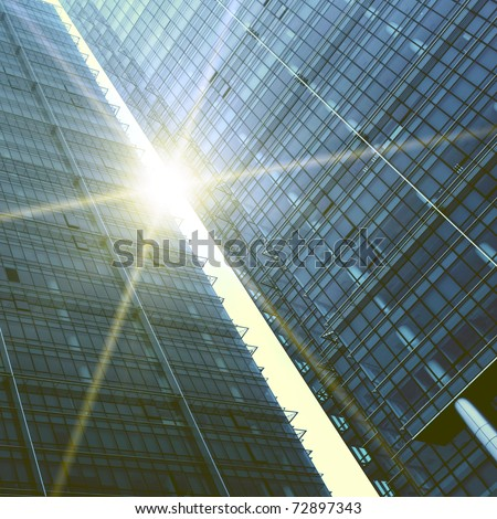 Abstract skyscrapers with sun glare