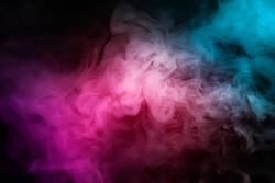 Abstract smoke steam moves on a black background . The concept of aromatherapy.