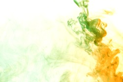 Abstract smoke Weipa. Personal vaporizers fragrant steam. Concept of alternative non-nicotine smoking. Green orange vape smoke on a white background. E-cigarette. Evaporator. Taking Close-up. Vaping.