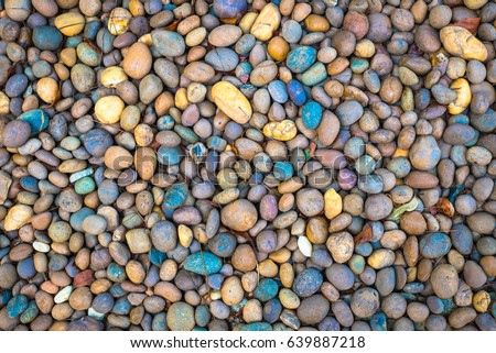 Abstract smooth round pebbles sea stone texture background. - Shutterstock ID 639887218