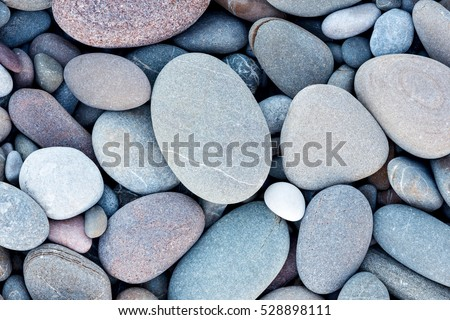 Abstract smooth round pebbles sea texture background - Shutterstock ID 528898111