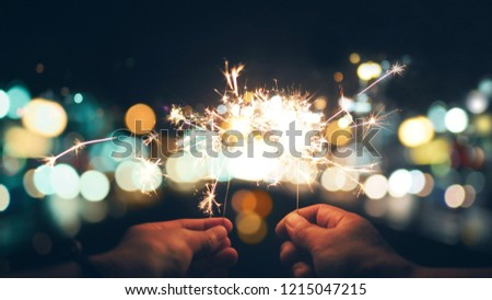 Abstract sparklers with city night light for christmas and new year eve celebrate holiday background, vintage color tone process style #1215047215