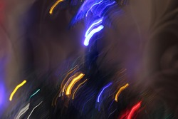 abstract sparks and lights of yellow and blue from Christmas decorations for the background