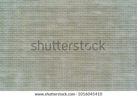 abstract speckled texture of fabric or textile material of gray yellow color for a background or for desktop wallpaper #1016045410