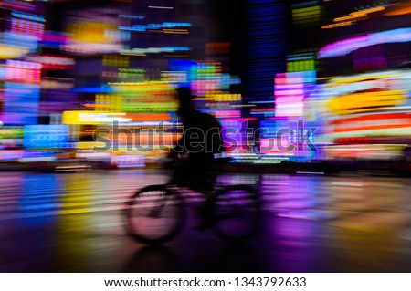 abstract speed motion blurred  of rider ride bicycle with neon light  from shinjuku,tokyo,japan  billboard background, urban night life #1343792633