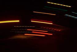 Abstract speed motion in urban highway road tunnel,blur driver view car drive on night road motion effect for background vintage color