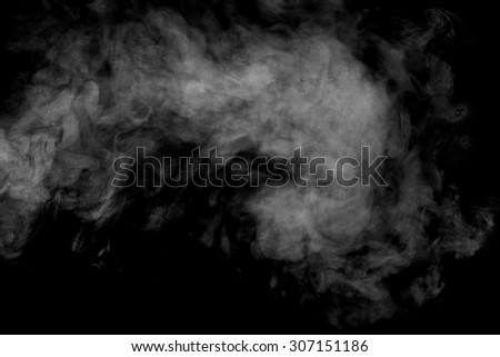 Abstract steam on a black background. Texture. Design element. Abstract art. The steam from the iron. Macro shooting.