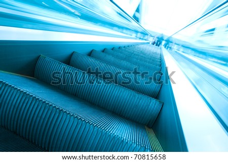abstract steps of vanishing escalator with persons on the top
