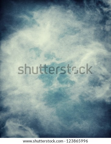 Abstract storm clouds on a textured paper background.  Image has a distinct grain pattern visible at 100%.