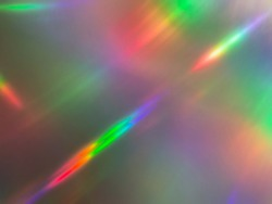 Abstract streaking rainbow light flares background or overlay
