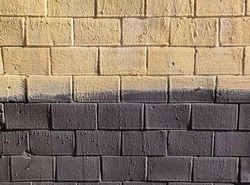 Abstract street brick wall background on sunny day