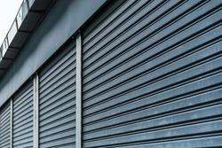 Abstract stripe pattern of metallic roller shutter doors or rolling steel doors background.