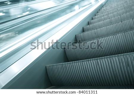 abstract striped texture of moving escalator closeup