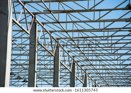 Abstract structure with rust metal and concrete beams