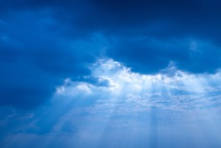 Abstract sun beam line light shining through the clouds, Sunbeam through the clouds haze on Beautiful sky,On blue clouds and light blue background,  before the rain