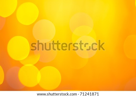 Abstract sunny bokeh on orange background