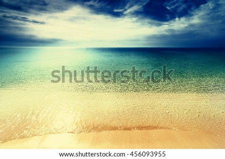 Abstract Sunny day sea paradise background in vintage style. Beautiful sea, sand, sky in summer time #456093955