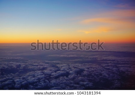 Abstract Sunset Photo from Airplane, Sunset sky background, pictured from plane. Beautiful sky as twilight times, Space for text in template.