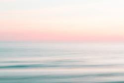 Abstract sunset sky and  ocean nature background with blurred panning motion.