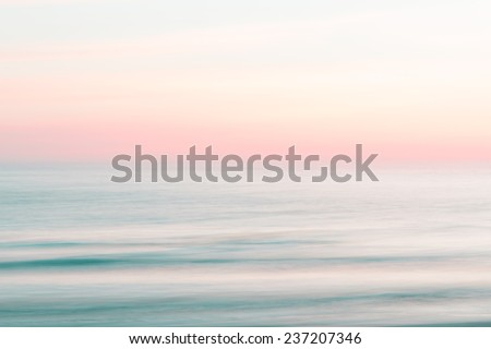 Stock Photo Abstract sunset sky and  ocean nature background with blurred panning motion.