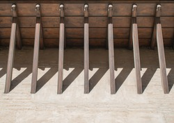 abstract support beams holding up a balcony