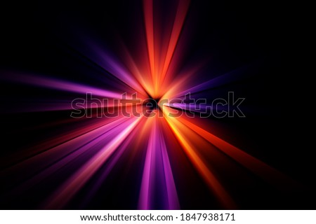 Abstract surface of a radial zoom blur in red, lilac, yellow tones on a black  background. Abstract bright background with radial, radiating, converging lines.