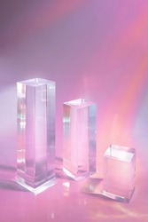 Abstract surreal scene - empty stage with three clear glass rectangle prism podiums on pastel holographic colored background. Pedestal for cosmetic product packaging mockups display presentation
