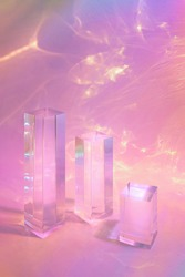 Abstract surreal scene - empty stage with three clear glass rectangle prism podiums on pastel neon holographic colored background. Pedestal for cosmetic product packaging mockups display presentation