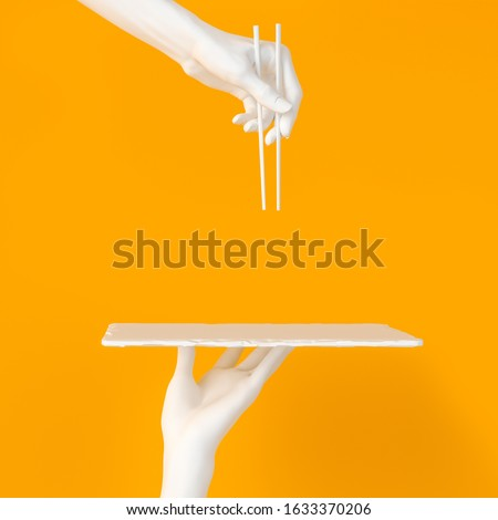 Abstract sushi bar concept background. White hands using chopsticks and sushi dish isolated on yellow, 3d illustration.