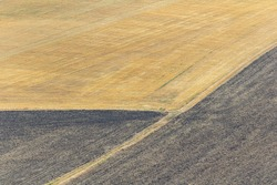 Abstract symmetry in agriculture field landscape. Minimalistic czech landscape