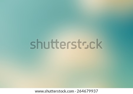 Abstract teal and sepia blurred background
