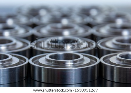 Abstract technical background for design and project. Metal parts machined on a lathe. Machined industrial parts.