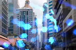 Abstract technology icons hologram over panorama city view of Singapore, Asia. The concept of people networking and connections. Double exposure.