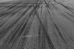 Abstract texture and background of car tire drift skid mark on road race track, Black tire mark on street race track, Automobile and automotive concept.