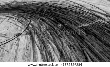 Abstract texture and background of car tire drift skid mark on road race track, Black tire mark on street race track, Automobile and automotive concept. Stock photo ©