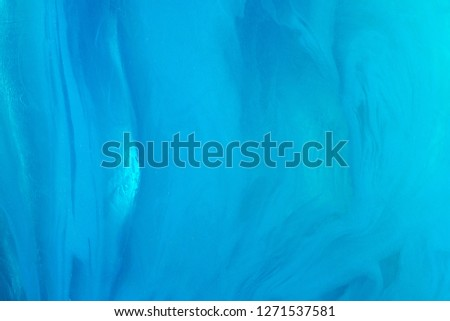 Abstract texture in the form of blue ice. Blue ice pattern with interlayers. Ice texture closeup. #1271537581