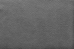 abstract texture of artificial leather fabric for a background and for wallpaper of black color