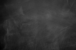 Abstract texture of chalk rubbed out on blackboard or chalkboard background, can be use as concept for school education, dark wall backdrop , design template , etc.