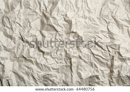 abstract texture of crumpled light brown recycled paper