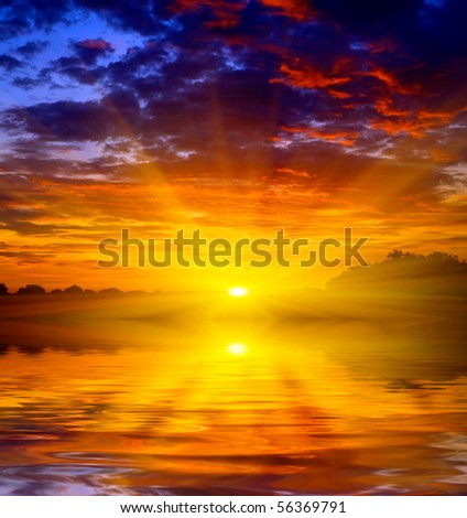 Abstract theme with hot sunset over water