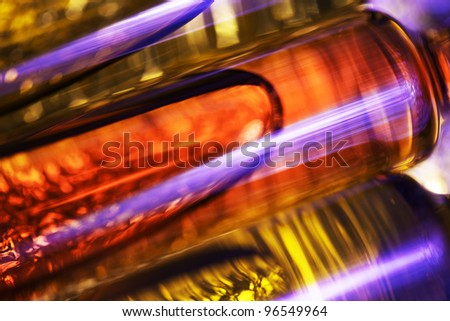 Abstract theme with three ampules. Very shallow depth of field.