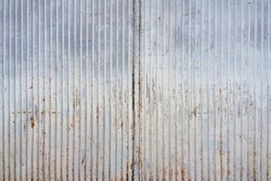 Abstract tin texture with rust and vertical lines. An old metal material texture for your design.