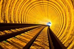 Abstract train moving in tunnel.