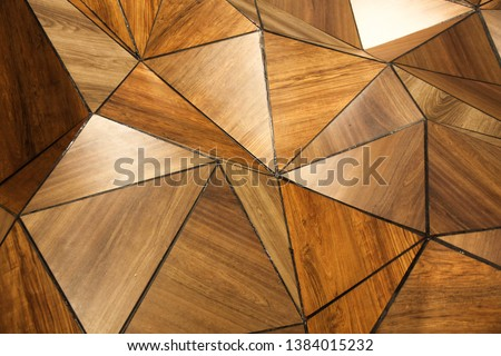 Abstract triangle background. Luxury geometric wood polygons. Architecture and interior decoration concept. Wooden backdrop. Golden reflection. Real wood plates with silicon grout detail.