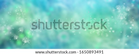 Abstract turquoise blue luminous background. Blurry nature view in spring. Flower dust in landscape. Illustration with space for design and text. Background for a environmental concept. Stock photo ©