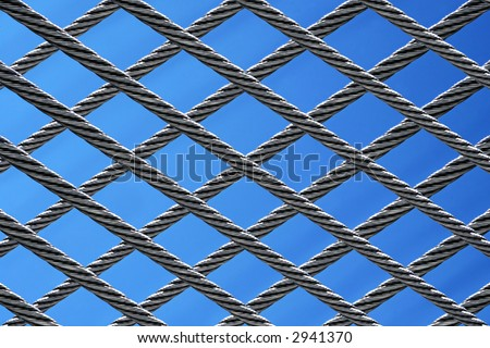 abstract twisted steel wires on blue sky background